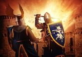 Knights fighting agaist medieval castle. — Stockfoto