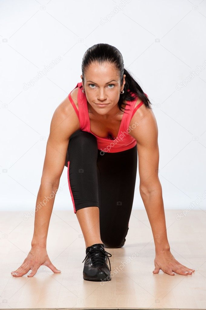 Beautiful athlete woman exercising in fitness club. — Stock Photo #10204291