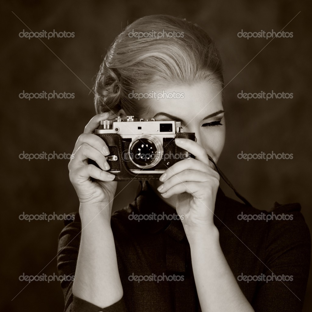 Woman in classic dress with retro camera. — Stock Photo #10204475