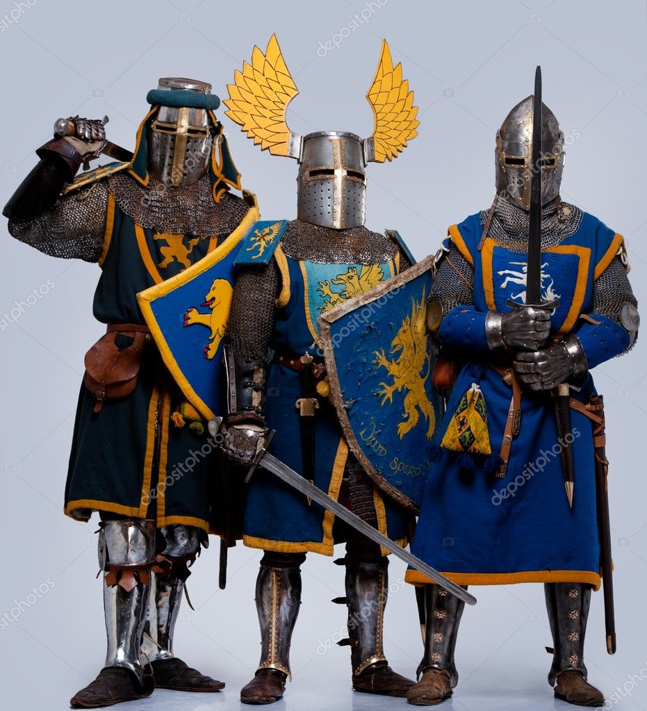 Three medieval knights isolated on grey background.  Stock Photo #10204872