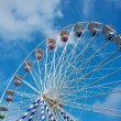 Ferris wheel against blue sky - Stockfoto