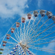 Ferris wheel against blue sky - Zdjęcie stockowe