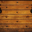 Metal hinges on wooden background. — Stock Photo