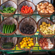 Vegetables in baskets on market place. - Photo