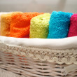 Colorful towels in basket. - Stok fotoğraf