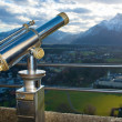 A telescope for observation of Salzburg city. - Stock Photo