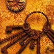 The old keys on the textured paper — Stok fotoğraf