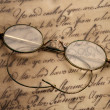 Old glasses on the vintage document — Stock Photo #10214645