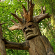 Pagan wooden idol in a woods - Stock Photo
