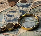 Old money with a lope on it — Stock Photo