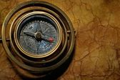 Vintage compass on the old textured paper — Stock Photo