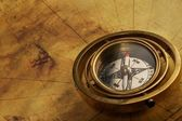 Vintage compass on the old map — Stockfoto