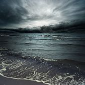 Stormy clouds over dark ocean — Stock Photo
