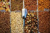 Market stand with fresh dried fruit and nuts — Stock Photo