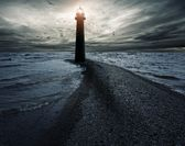 Stormy sky over lightouse — Stock Photo