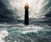 Stormy sky over lightouse — Stockfoto