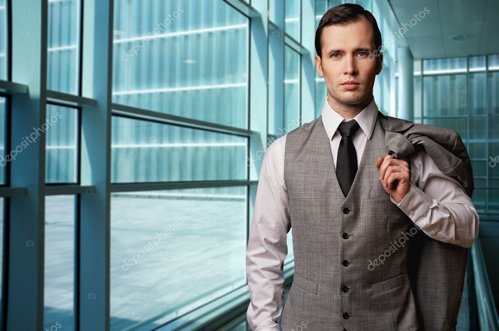 Man in grey suite in modern building. — Stock Photo #10213213