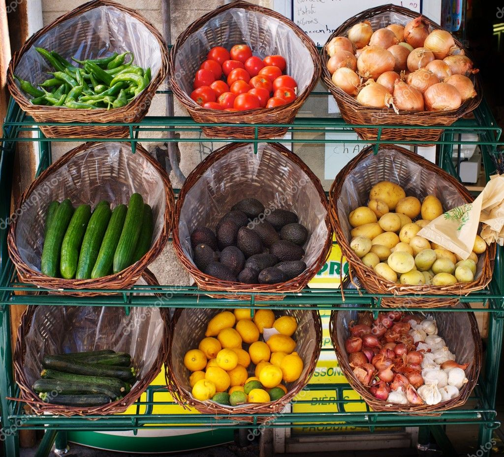 Vegetables in baskets on market place.  Stock Photo #10213384