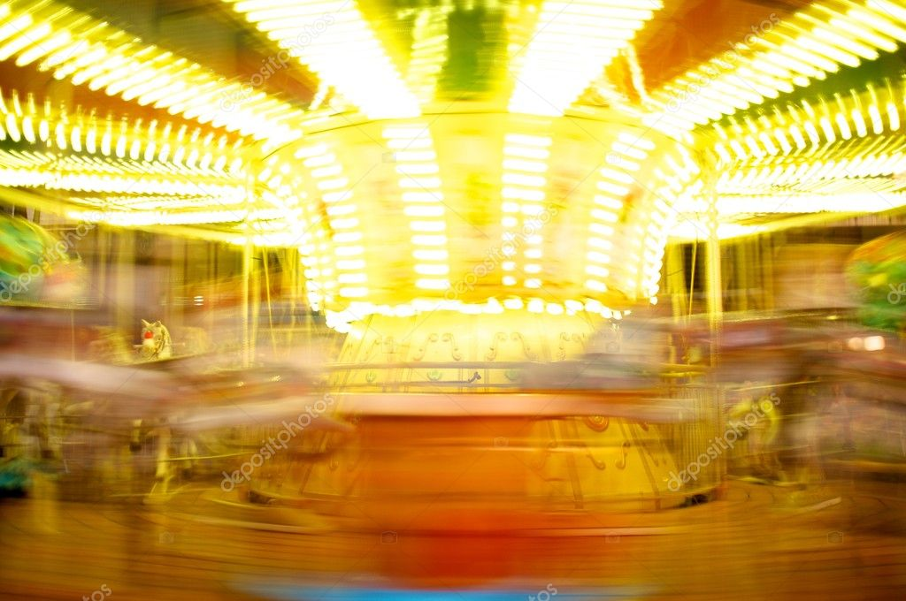 Merry-go-round in motion blur  Stock Photo #10213608