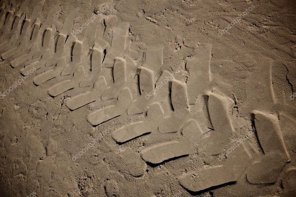 Tire marks on a sand  Stock Photo #10215276