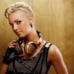 Punk girl with headphones — Stock Photo