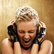 Punk girl with headphones — Stock Photo