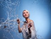 Woman in winter forest — Stok fotoğraf