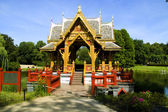 The Asian pagoda against lake and wood — Stockfoto