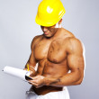 Young sexy worker writing on clipboard — Stock Photo