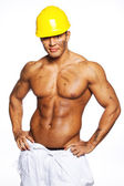 Image of young handsome builder posing — Stock Photo