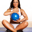 Blue fitness ball in girl's hands — Stock Photo
