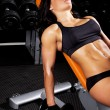 Female athlete is on bench — Stockfoto