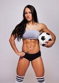Soccer ball is in brunette hands — Stock Photo