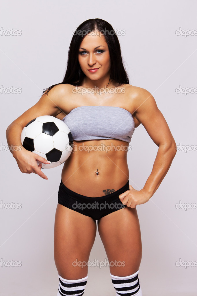 Soccer ball is in brunette hands  Stock Photo #9724972