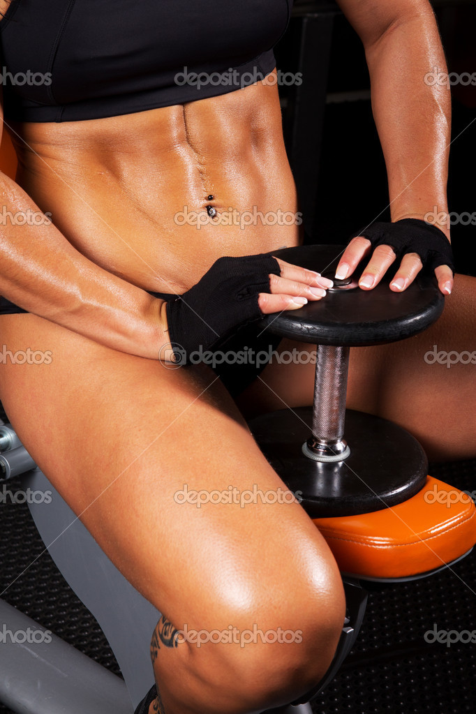 Close image of sitting woman with dumbbels — Stock Photo #9877989