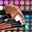 Make-up brushes and makeup shadows — Stock Photo