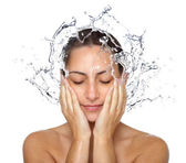 Wet woman face with water drops — Stock Photo