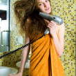 Beautiful woman drying her hair — Stock Photo