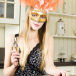 Stock Photo: Beautiful blonde in a venetian mask