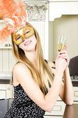 Beautiful blonde in a venetian mask — Stock Photo