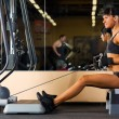 Beautiful woman is doing gym exercises — Stock Photo