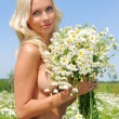Naked woman at the meadow with bunch of chamomiles. — Stock Photo #9122862