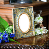 Still life with antique ornate frame. — Stock Photo