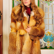 Beautiful woman in fur coat in the luxurious classical interior. — Stock Photo #9209368