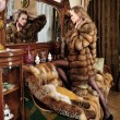 Woman in fur coat at the mirror in Luxurious classical interior. — Stock Photo #9209379