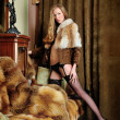 Woman in fur coat at the mirror in Luxurious classical interior. — Stock Photo #9209389