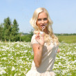 Beautiful woman on the meadow with bubbles — Stock Photo