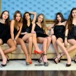 Six beautiful sexy models in the hotel. — Stock Photo