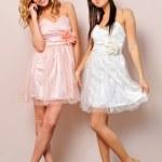 Two beautiful women in fancy dresses. — Stock Photo