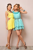 Two beautiful women in summer dresses. — Stock Photo
